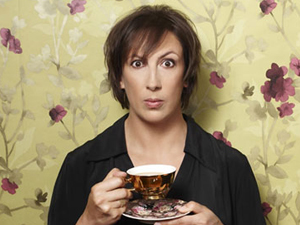 Miranda Hart with cup and saucer and floral background