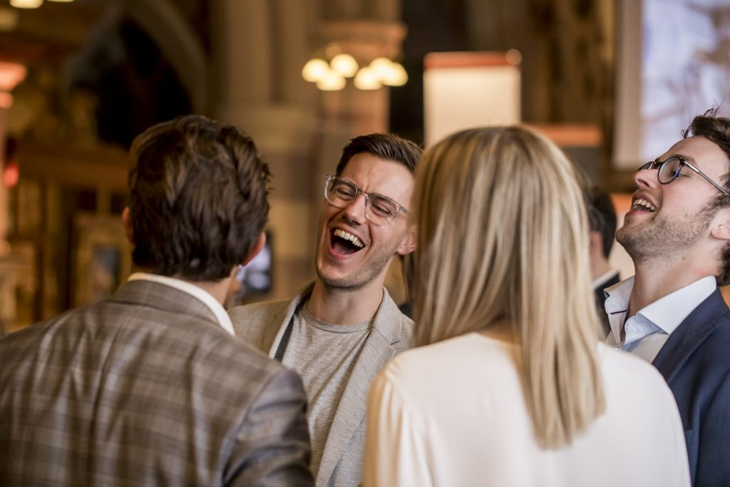 Laughing man in networking group